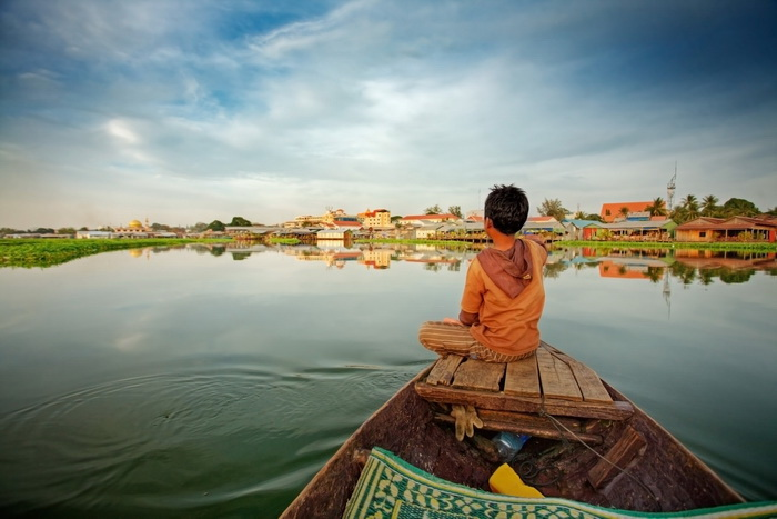 Boy on a boat on Tonle Sap Lake - Insight To Asia Tours
